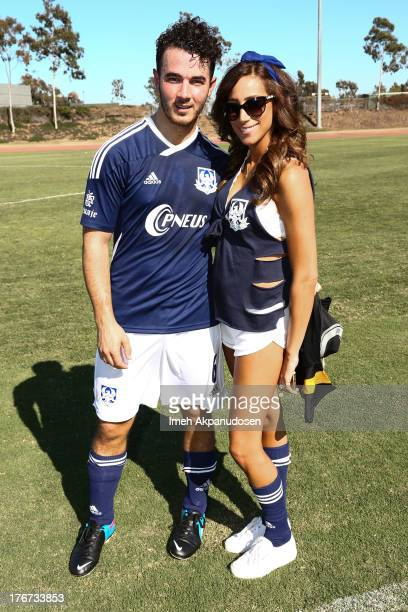 Musician Kevin Jonas of The Jonas Brothers and his wife Danielle Jonas attend a charity soccer match at StubHub Center on August 17 2013 in Los...