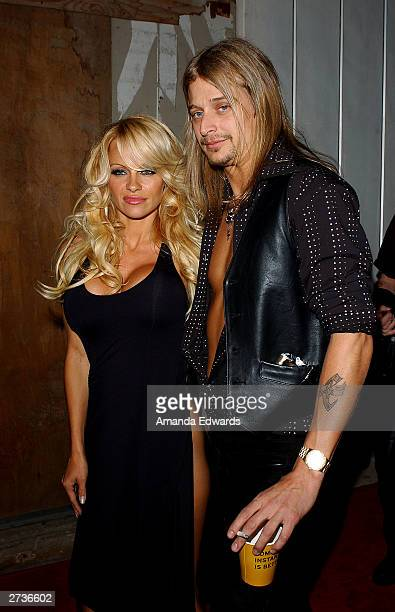 Musician Kid Rock and actress Pamela Anderson arrive at the Kid Rock AfterParty for the American Music Awards at Forbidden City on November 16 2003...