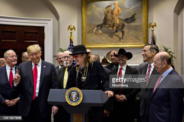 Musician Kid Rock center speaks as US President Donald Trump left and Wilbur Ross US commerce secretary right listen during a signing ceremony for HR...