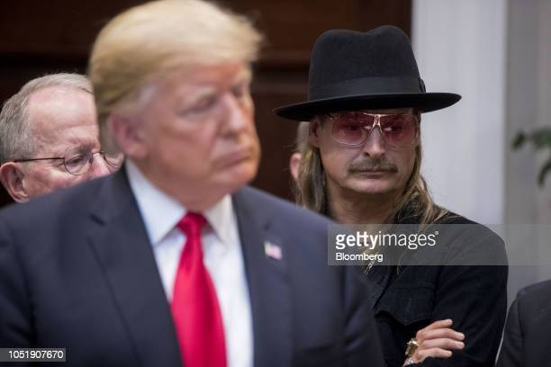 Musician Kid Rock right and US President Donald Trump left listen during a signing ceremony for HR 1551 the HatchGoodlatte Music Modernization Act in...
