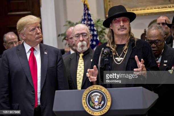 Musician Kid Rock right speaks as US President Donald Trump left listens during a signing ceremony for HR 1551 the HatchGoodlatte Music Modernization...