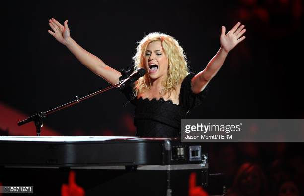 Musician Kimberly Perry of The Band Perry performs on stage at the 2011 CMT Music Awards at the Bridgestone Arena on June 8 2011 in Nashville...
