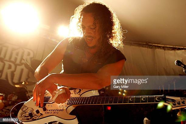 """Musician Kirk Hammett of Metallica performs at a secret show celebrating the release of Activision's """"Guitar Hero: Metallica"""" at Stubb's during 2009..."""