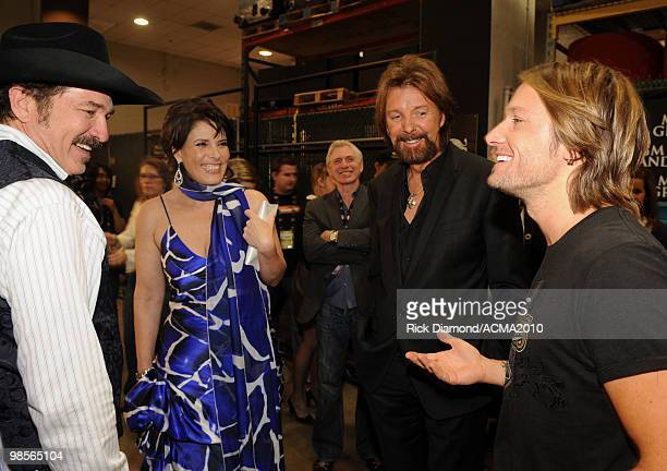 Musician Kix Brooks and wife Barbara Brooks with musicians Ronnie Dunn and Keith Ubrban pose backstage during Brooks Dunn's The Last Rodeo Show at...
