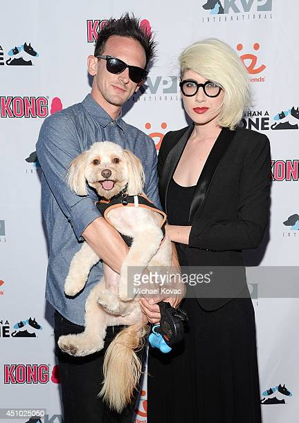 Musician Kris Kovacs of musical group 'Deluka' and DJ Whitney Fierce enjoy the 'More Than a Cone' art auction and campaign launch benefiting Best...