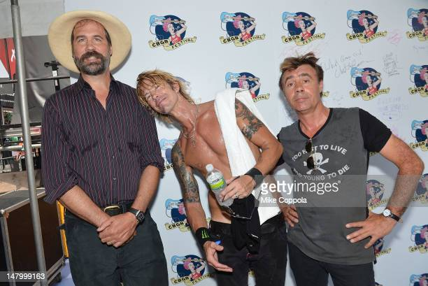 Musician Krist Novoselic, Duff McKagan of the band Loaded, and Glen Matlock of the Sex Pistols pose for a picture backstage at the 2012 CBGB Festival...