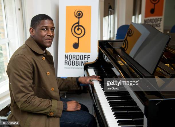 Musician Labrinth plays a piano during his visit to the Nordoff Robbins music therapy centre on April 23 2013 in London England