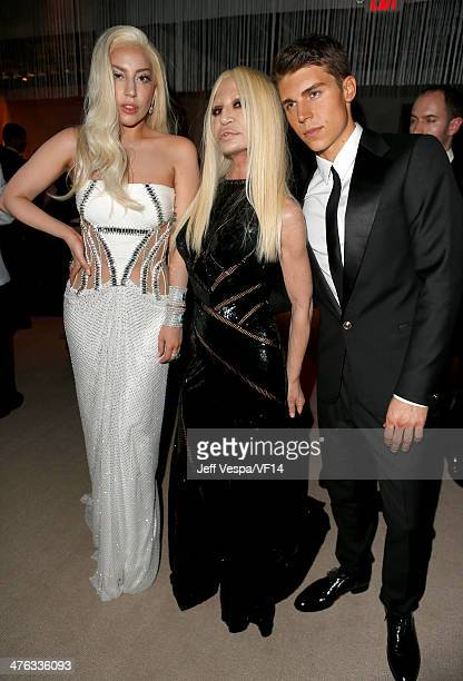 Musician Lady Gaga designer Donatella Versace and actor Nolan Gerard Funk attend the 2014 Vanity Fair Oscar Party Hosted By Graydon Carter on March 2...