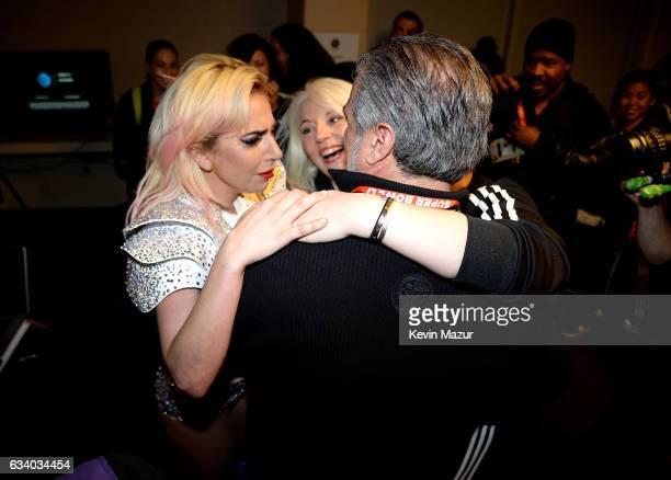 Musician Lady Gaga hugs her parents Cynthia Germanotta and Joe Germanotta backstage after the Pepsi Zero Sugar Super Bowl LI Halftime Show at NRG...