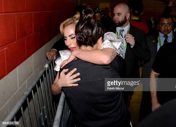 Musician Lady Gaga hugs her sister Natali Germanotta backstage after the Pepsi Zero Sugar Super Bowl LI Halftime Show at NRG Stadium on February 5,...