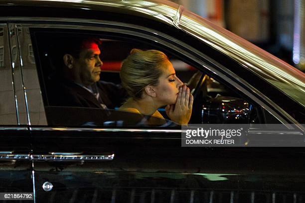TOPSHOT Musician Lady Gaga sits in her car after staging a protest against Republican presidential nominee Donald Trump outside Trump Tower in New...