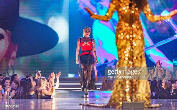 Musician Lady Gaga speaks onstage during the 2018 MTV Movie And TV Awards at Barker Hangar on June 16 2018 in Santa Monica California