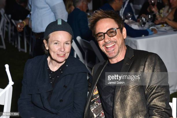 Musician Laurie Anderson and actor Robert Downey Jr attend The 24th Annual Watermill Center Summer Benefit Auction at The Watermill Center on July 29...