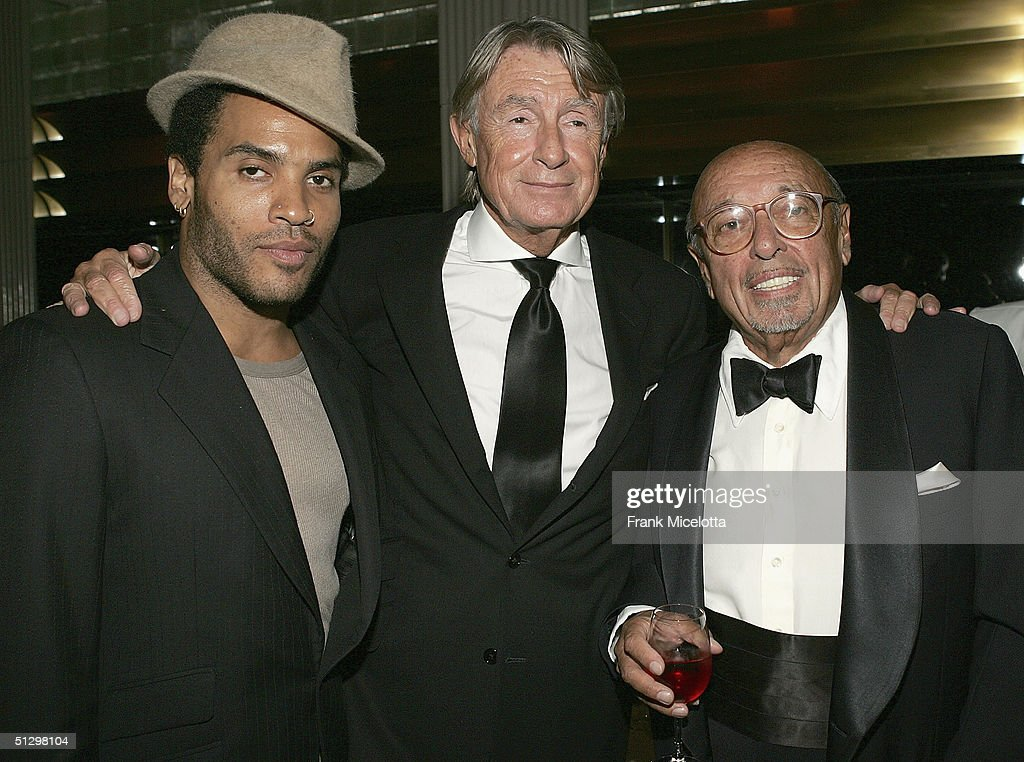 Musician Lenny Kravitz, director Joel Schumacher, and Ahmet Ertegun at the surprise 80th birthday party for legendary musician Bobby Short, September 12, 2004 at the Rainbow Room in New York City.