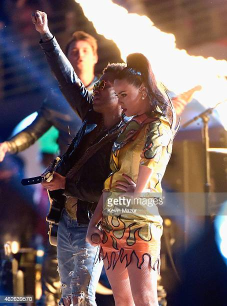 Musician Lenny Kravitz performs onstage with recording artist Katy Perry during the Pepsi Super Bowl XLIX Halftime Show at University of Phoenix...