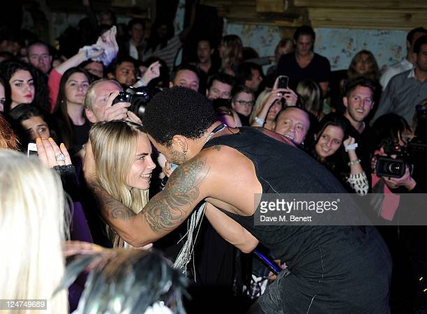 Musician Lenny Kravitz sings to model Cara Delevingne at a gig with Absolute Radio launching his new album 'Black and White America' at The Box Soho...