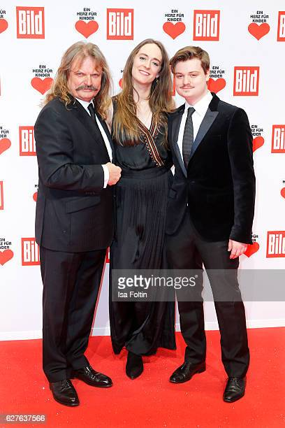 Musician Leslie Mandoki and his son Gabor Mandoki with his girlfriend Sophia attend the Ein Herz Fuer Kinder gala on December 3 2016 in Berlin Germany