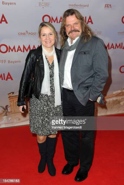 Musician Leslie Mandoki and his wife Eva attend the 'Omamamia' Germany Premiere at the Mathaeser Filmpalast on October 17 2012 in Munich Germany