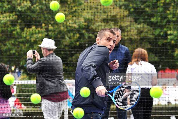 Musician Liam Gallagher faces the hotshots ball kids during day 9 of the 2014 Australian Open at Melbourne Park on January 21 2014 in Melbourne...