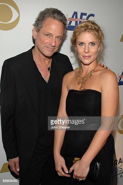Musician Lindsey Buckingham of Fleetwood Mac and wife Kristen Buckingham arrive at The GRAMMY Nominations Concert Live held at the Nokia Theatre on...