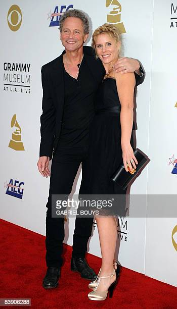 Musician Lindsey Buckingham of Fleetwood Mac arrives with his wife Kristen Buckingham at the Nokia Theater in downtown Los Angeles December 3 to...