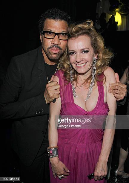 Musician Lionel Richie and Chopar Co-President Caroline Gruosi-Scheufele attend the Artists for Peace and Justice Fundraiser at the VIP Room, Palm...