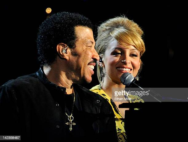 Musician Lionel Richie and his daughter Nicole Richie perform onstage during Lionel Richie and Friends in Concert presented by ACM held at the MGM...