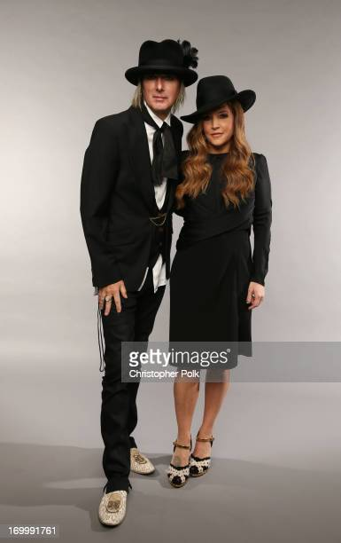 Musician Lisa Marie Presley and Michael Lockwood pose at the Wonderwall portrait studio during the 2013 CMT Music Awards at Bridgestone Arena on June...
