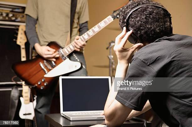 Musician listening to headphones