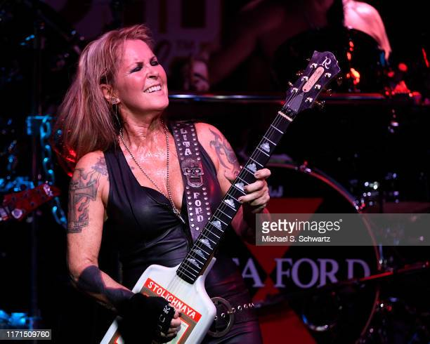 Musician Lita Ford performs during her appearance with Lita Ford in concert at The Canyon Club on August 31 2019 in Santa Clarita California