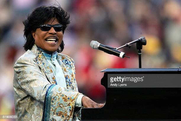 Musician Little Richard performs during the halftime show of the game between the Louisville Cardinals and the Boise State Broncos in the AutoZone...
