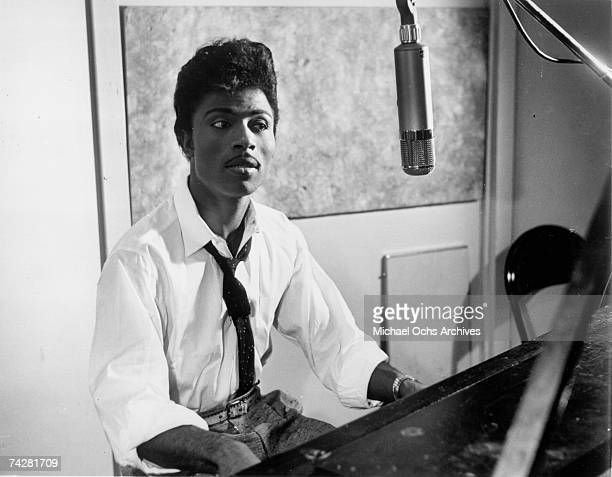 Musician Little Richard performs on the recording studio at a microphone and piano in circa 1959