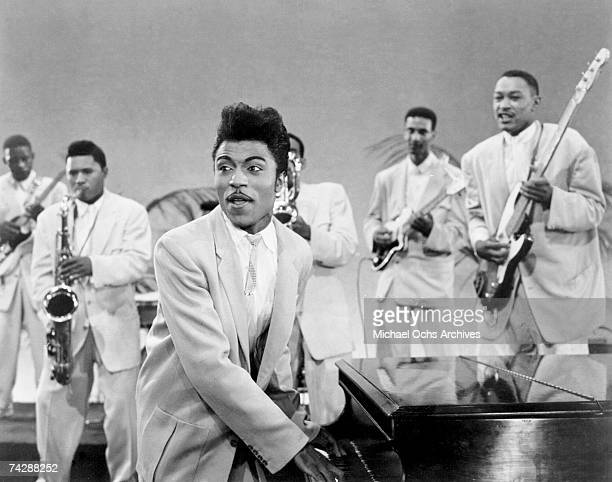 Musician Little Richard performs onstage with his band as his saxophone player Grady Gaines stands on the piano in circa 1957 in scene from the movie...