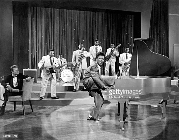 Musician Little Richard performs onstage with his band in 1956.