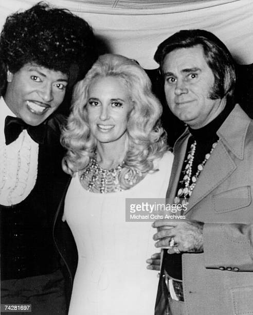 Musician Little Richard poses with married country couple Tammy Wynette and George Jones in circa 1972