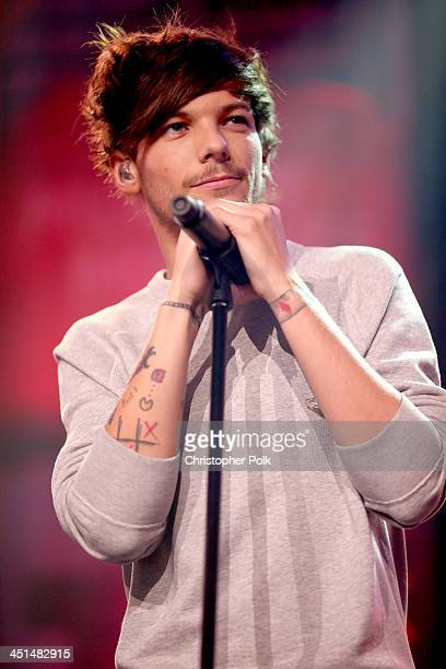 Musician Louis Tomlinson performs onstage at the One Direction iHeartRadio Album Release Party hosted by Ryan Seacrest at the iHeartRadio Theater Los...