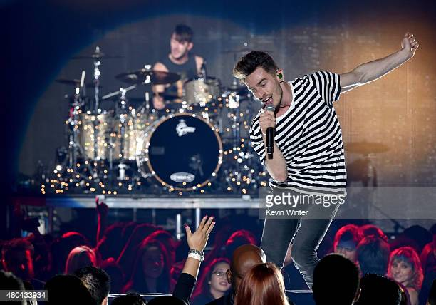 Musician Louis Vecchio and singer David Boyd of New Politics perform onstage during day one of the 25th annual KROQ Almost Acoustic Christmas at The...