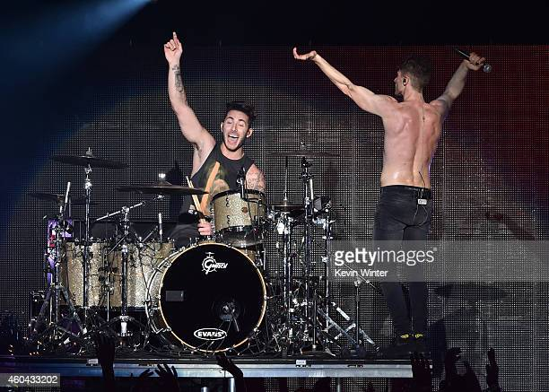 Musician Louis Vecchio and singer David Boyd performs onstage during day one of the 25th annual KROQ Almost Acoustic Christmas at The Forum on...