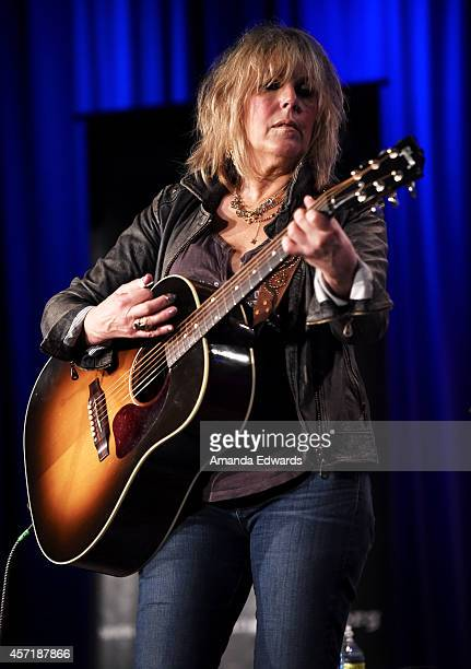 Musician Lucinda Williams performs onstage at The Drop Lucinda Williams at The GRAMMY Museum on October 13 2014 in Los Angeles California