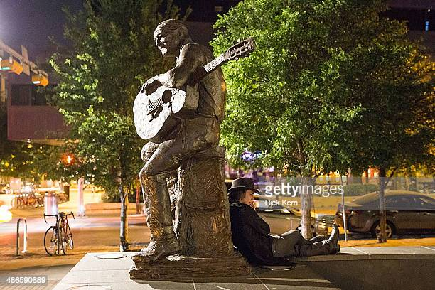 Musician Lukas Nelson rests against a statue of his father Willie Nelson after attending the second Mack Jack McConaughey charity gala at ACL Live on...