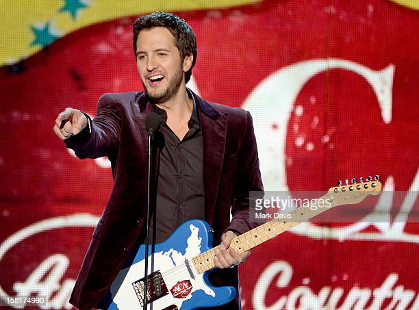 Musician Luke Bryan accepts the Artist of the Year award onstage during the 2012 American Country Awards at the Mandalay Bay Events Center on...