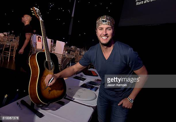 Musician Luke Bryan attends the charities signings during the 2016 MusiCares Person Of The Year honoring Lionel Richie at Los Angeles Convention...