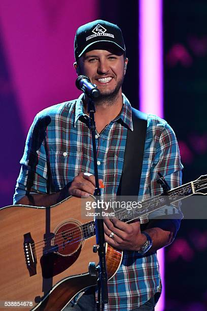 Musician Luke Bryan performs onstage during the 2016 CMT Music awards at the Bridgestone Arena on June 8 2016 in Nashville Tennessee