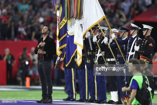 Musician Luke Bryan sings the national anthem prior to Super Bowl 51 between the Atlanta Falcons and the New England Patriots at NRG Stadium on...