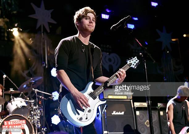 Musician Luke Hemmings of 5 Seconds of Summer performs onstage during 1061 KISS FM's Jingle Ball 2015 presented by Capital One at American Airlines...
