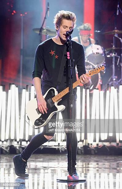 Musician Luke Hemmings of the band 5 Seconds of Summer performs onstage at the 2014 American Music Awards at Nokia Theatre LA Live on November 23...