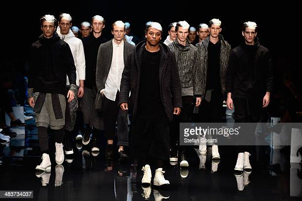 Musician Lupe Fiasco and models walk the runway at the Song For The Mute show during MercedesBenz Fashion Week Australia 2014 at Carriageworks on...