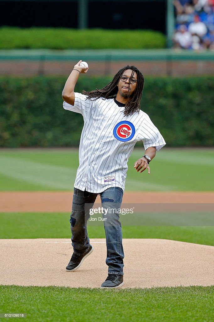 Musician Lupe Fiasco throws out a ceremonial first pitch before the game between the Chicago Cubs and the St. Louis Cardinals at Wrigley Field on September 24, 2016 in Chicago, Illinois.