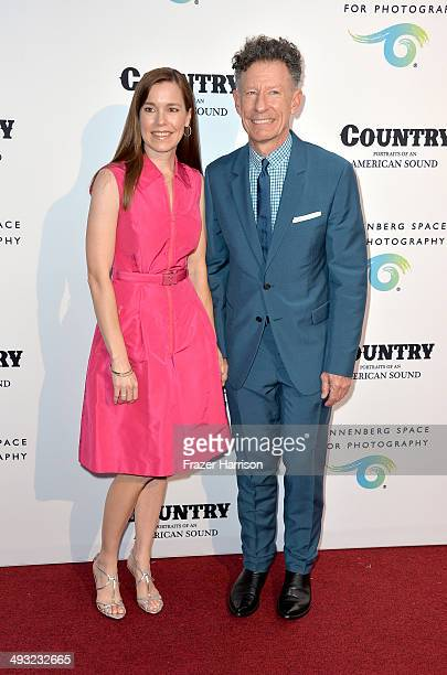 Musician Lyle Lovett and April Kimble attend the Annenberg Space for Photography Opening Celebration for Country Portraits of an American Sound at...