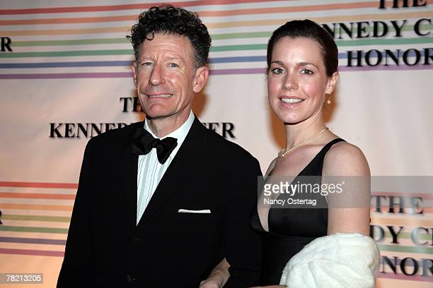 Musician Lyle Lovett and girlfriend April Kimble arrive at the 30th Annual Kennedy Center Honors December 2 2007 in Washington DC